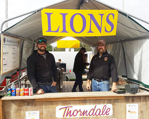 Lions selling food at the fair